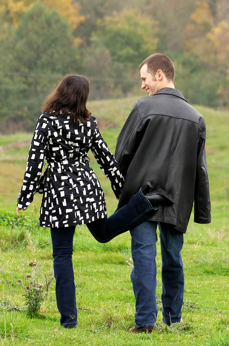 girl gives fiance a playful tap during country engagement session near Peterbrough, ON