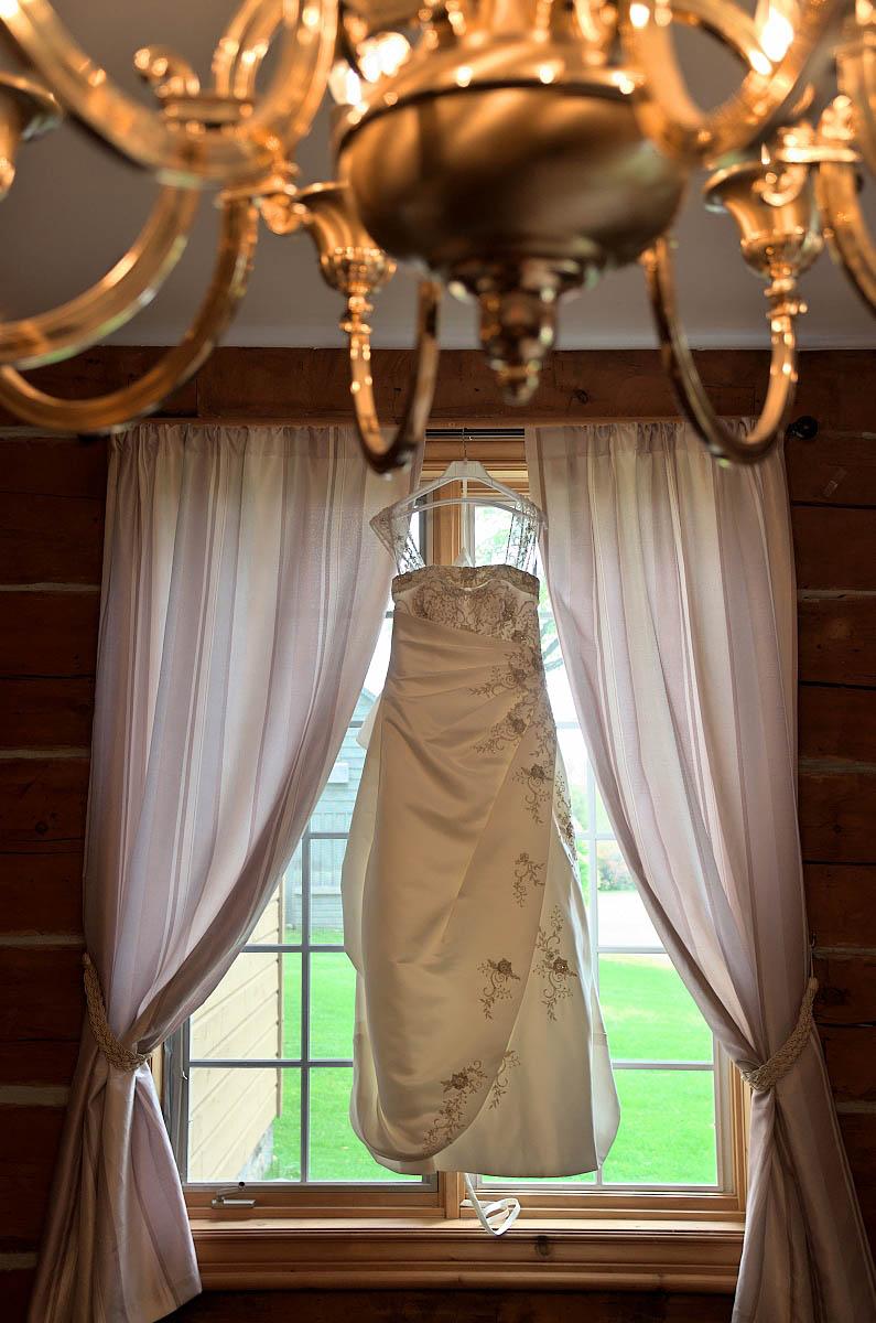 Wedding dress hanging in window of Dunsford House at Eganridge Resort in Fenelon Falls
