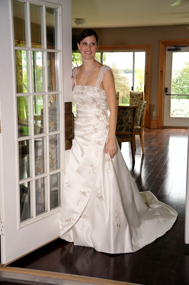 Beautiful bride by French Doors at THe Dunsford House at Eganridge Resort in Fenelon Falls