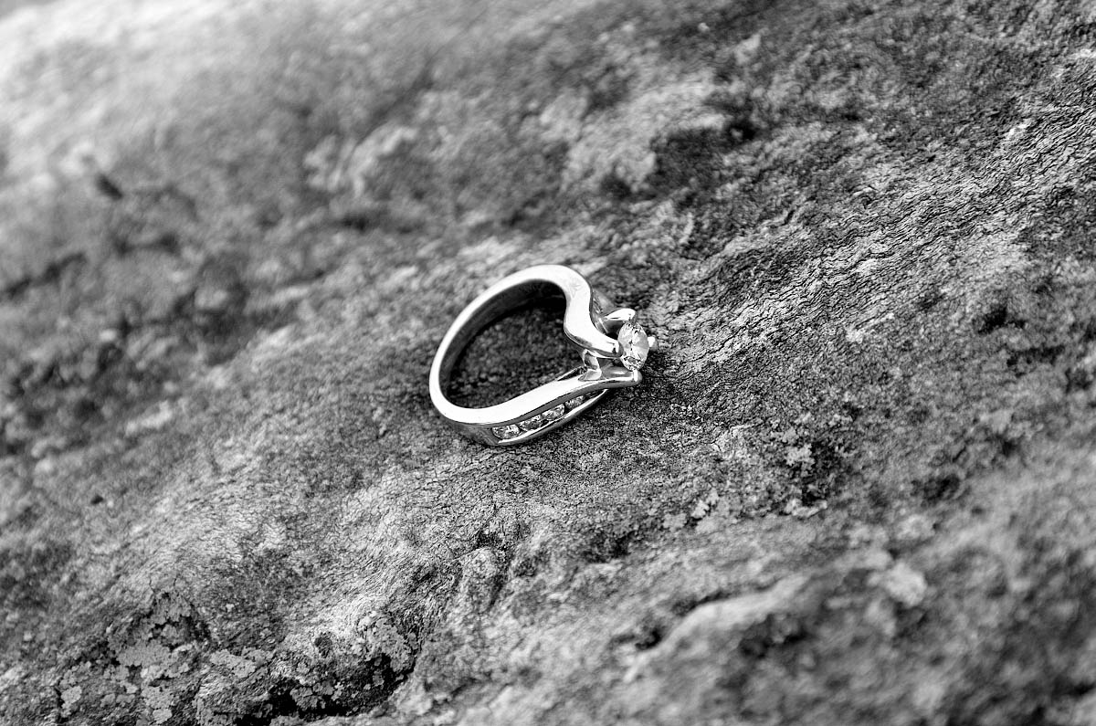 engagement ring on lichen covered boulder at kawartha lakes engagement shoot