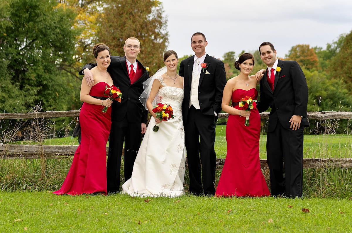 wedding party by split rail fence at Eganridge Golf Club wedding