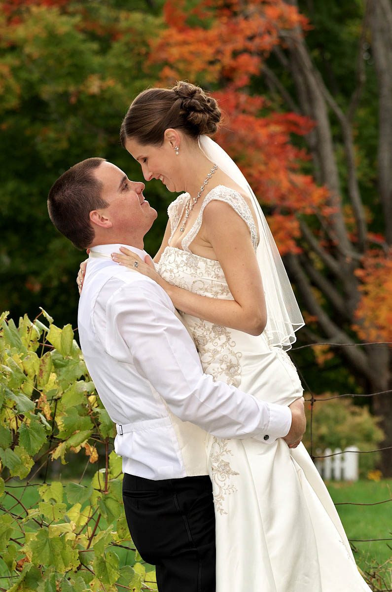 Groom lifts his bride in his arms at Eganridge wedding