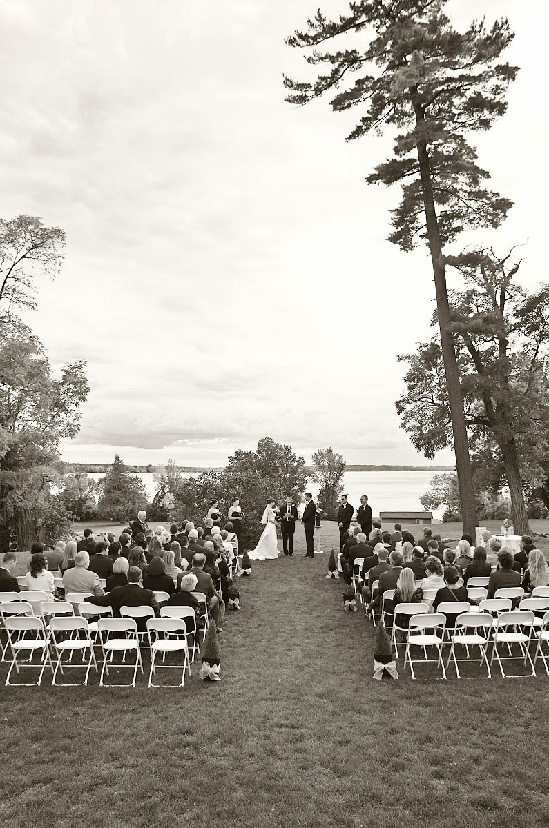 Summer wedding ceremony at The Dunsford House at Eganridge Resort overlooking Sturgeon Lake