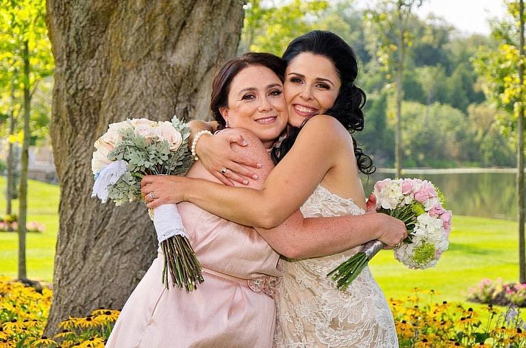 bride with bridesmaid in royal ambassador garden