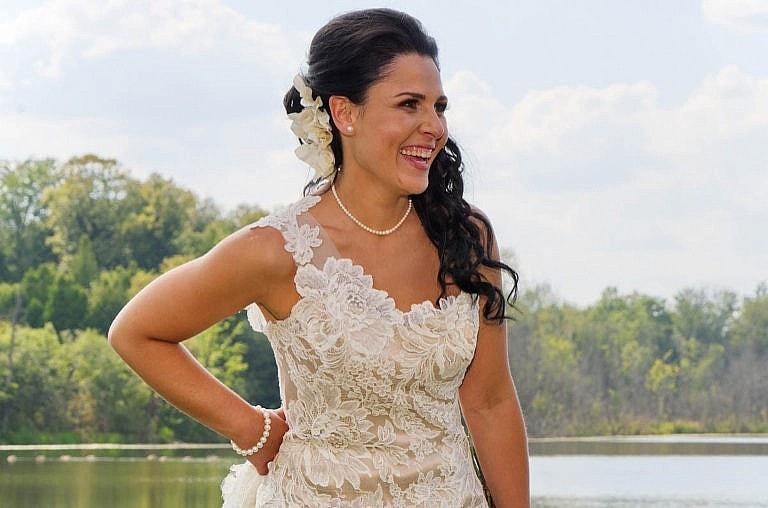 bride by pond at royal ambassador