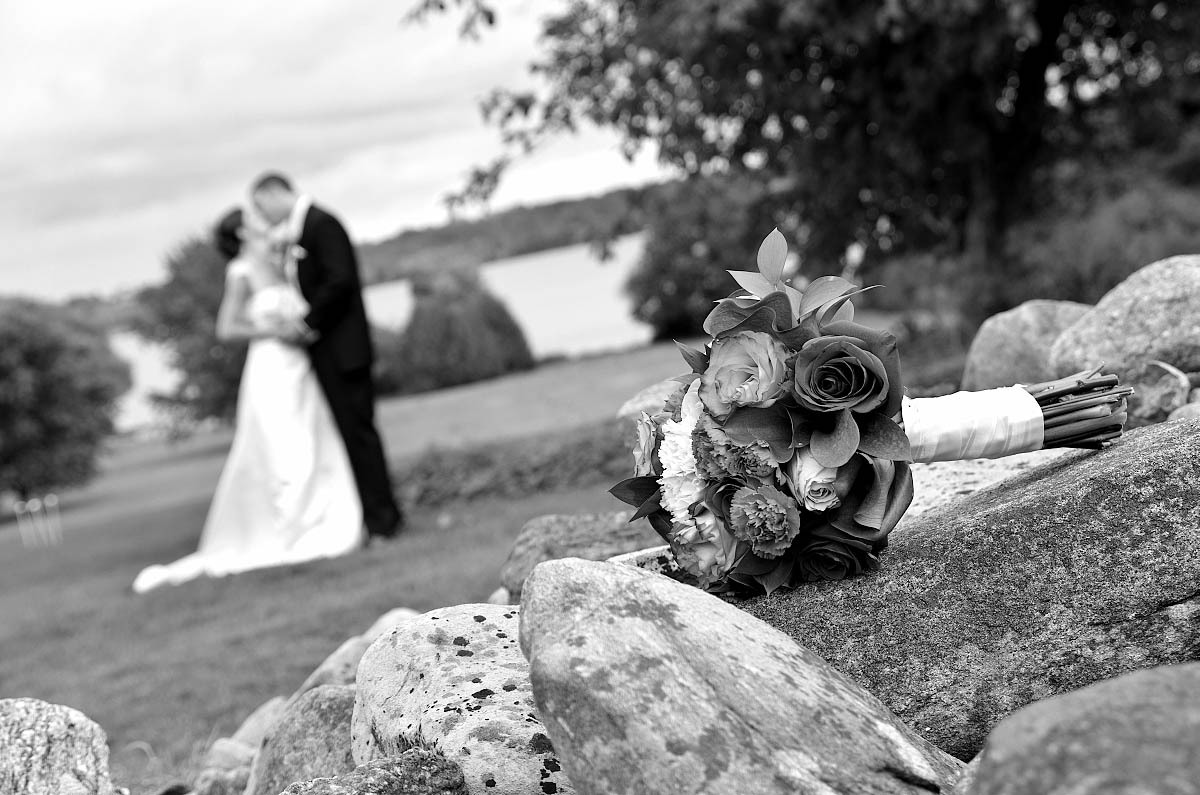 Wedding couple wiith bouquet and old stone wall at Eganridge wedding