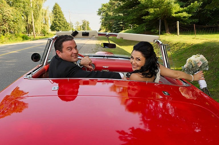 wedding couple with vintage car at caledon wedding at royal ambassador
