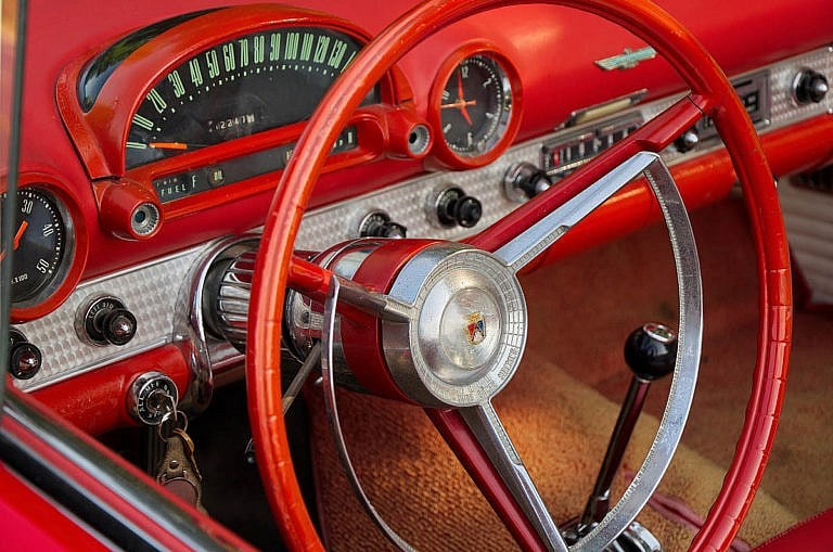 close up of red thunderbird steering wheel