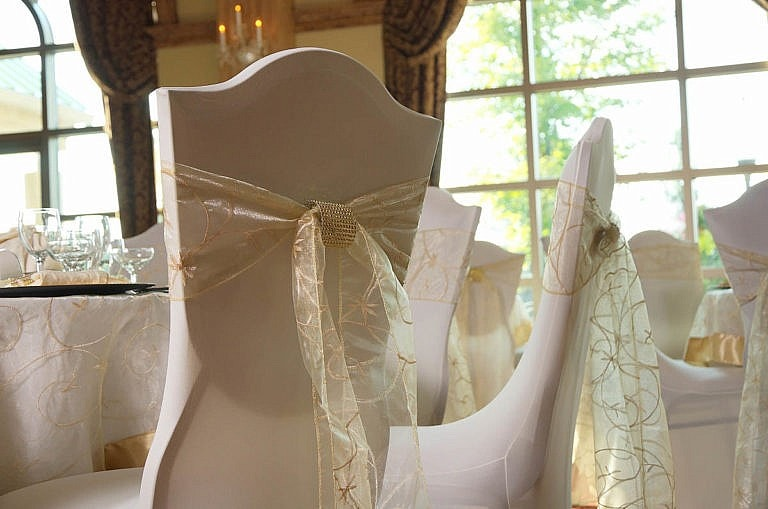 elegant chair coverings at caledon wedding