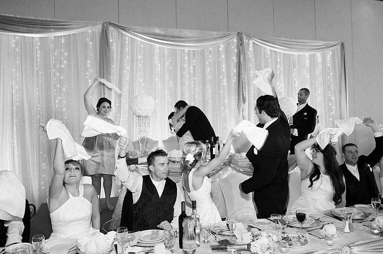 kissing game at wedding reception