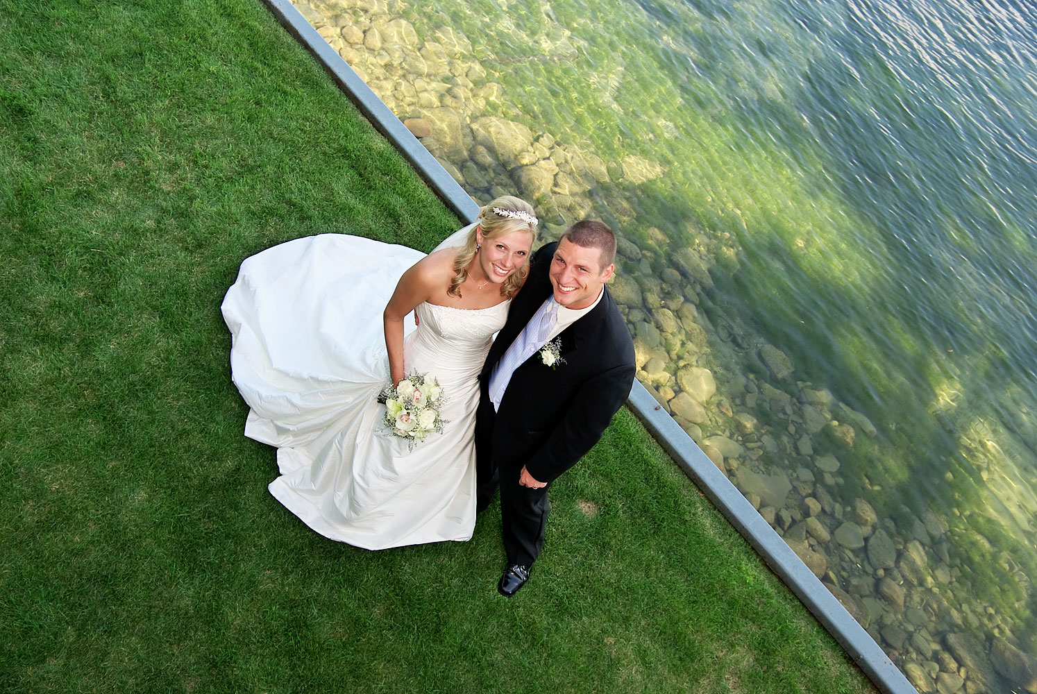 barrie photographer Bride and Groom by Lake Simcoe at Barrie wedding