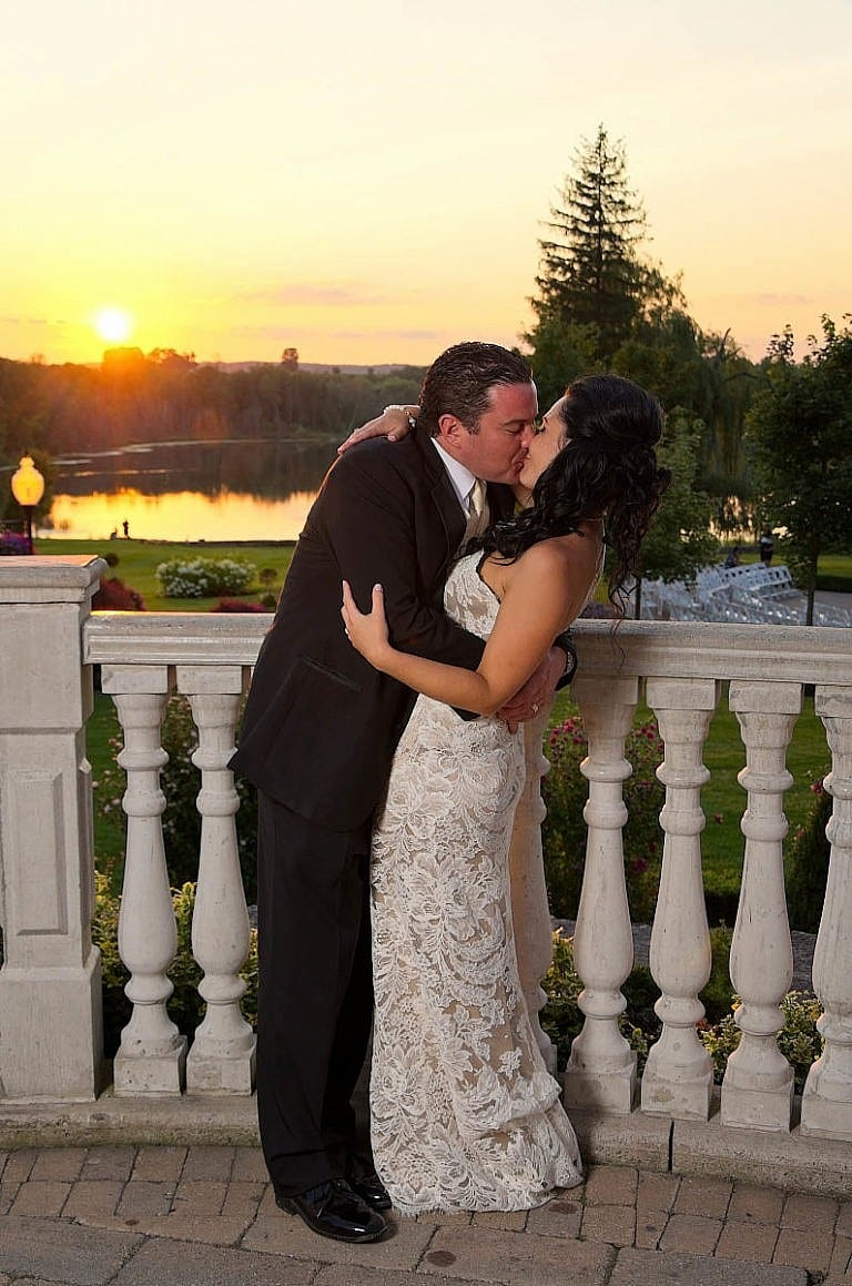 bride and groom kiss at sunset in garden at Royal Ambassador wedding in Caledon