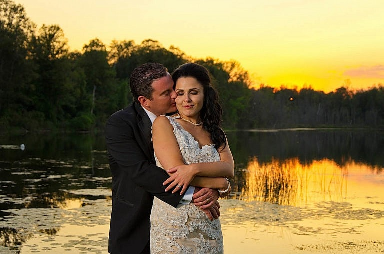 bride and groom in front of pond at sunset at caledon wedding at Royal ambassador