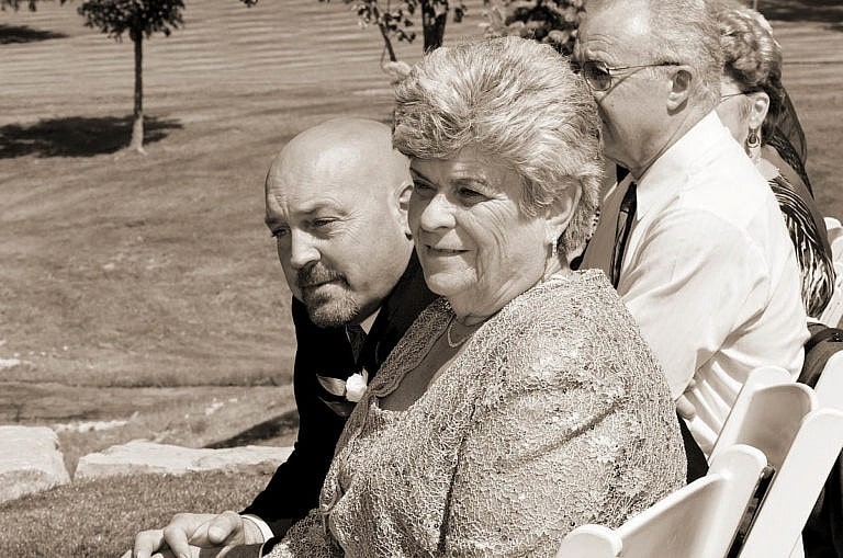 proud parents watching wedding ceremony