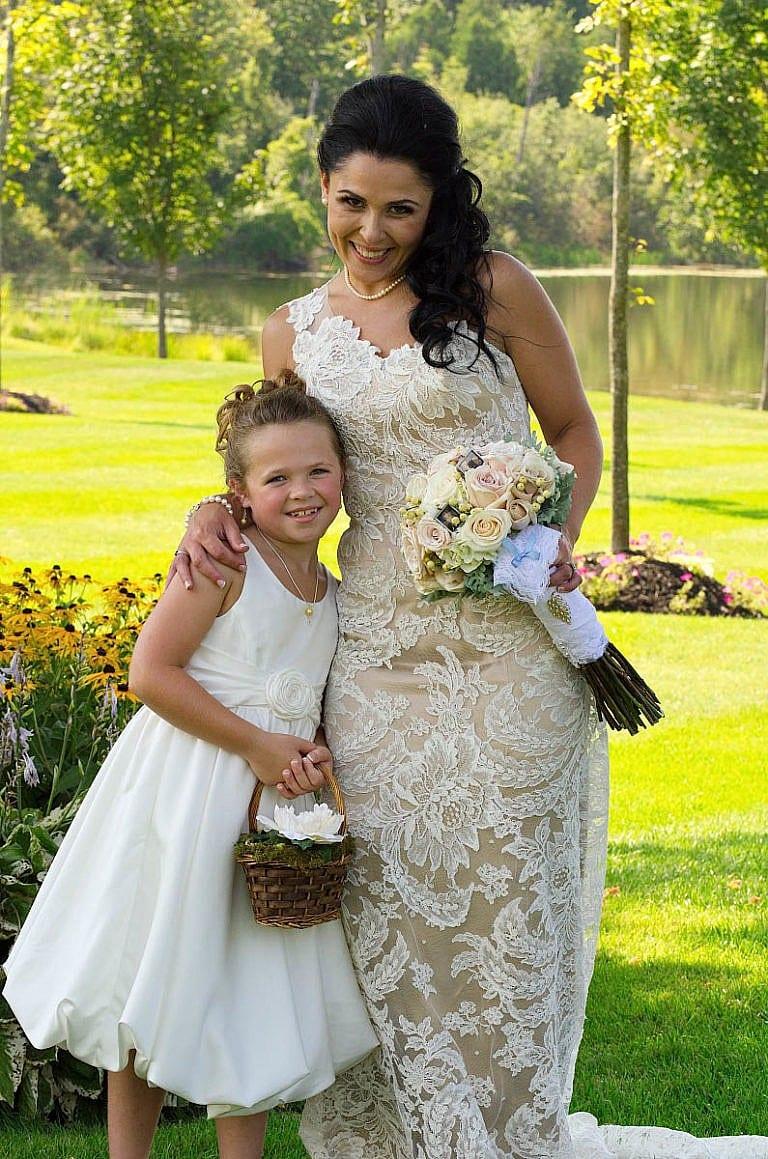 Bride with flower girl at Caledon Wedding at Royal Ambassador