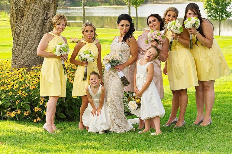 Sassy Bridesmaids in garden at Royal Ambassador wedding