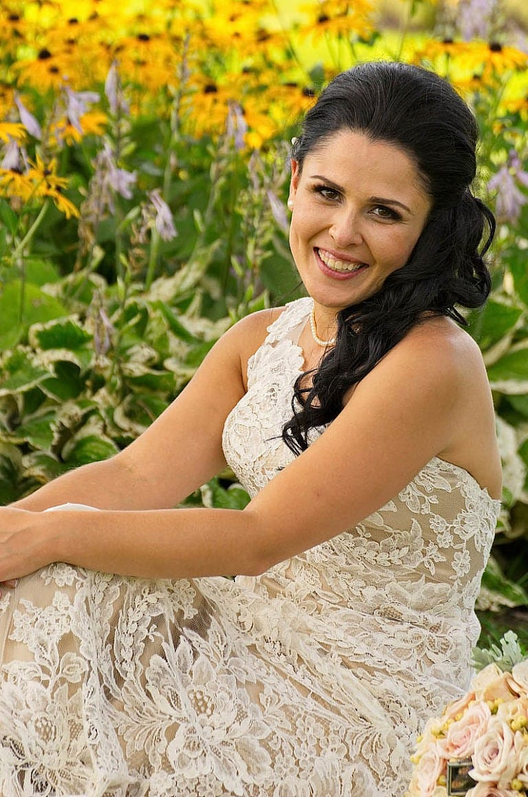 Beautiful bride in garden at Royal Ambassador wedding