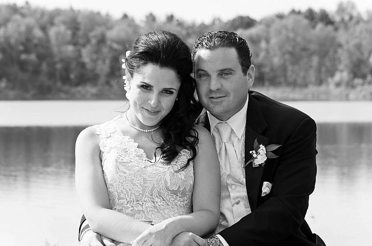 wedding couple in front of pond at Royal Ambassador in Caledon, Ontario