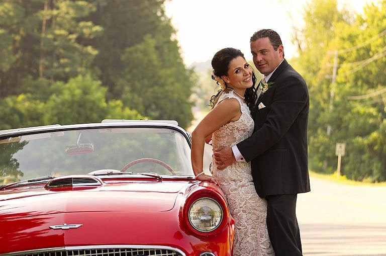Couple with cherry red vintage car at Caledon wedding at Royal Ambassador