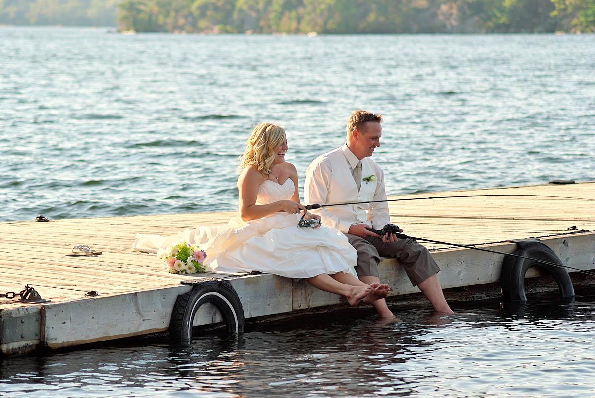 wedding couple fishing on docks at irwin inn wedding near lakefield