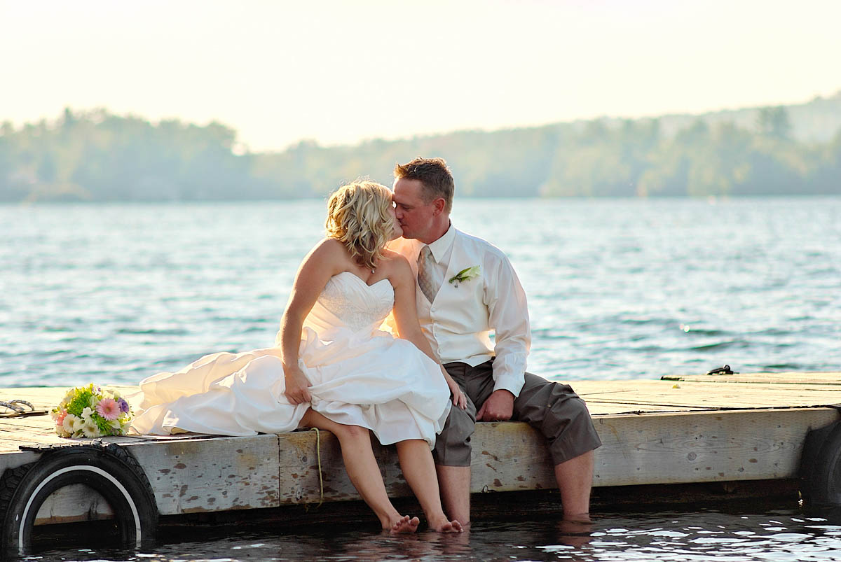 Wwedding couple kisses on dock at Irwin Inn Wedding