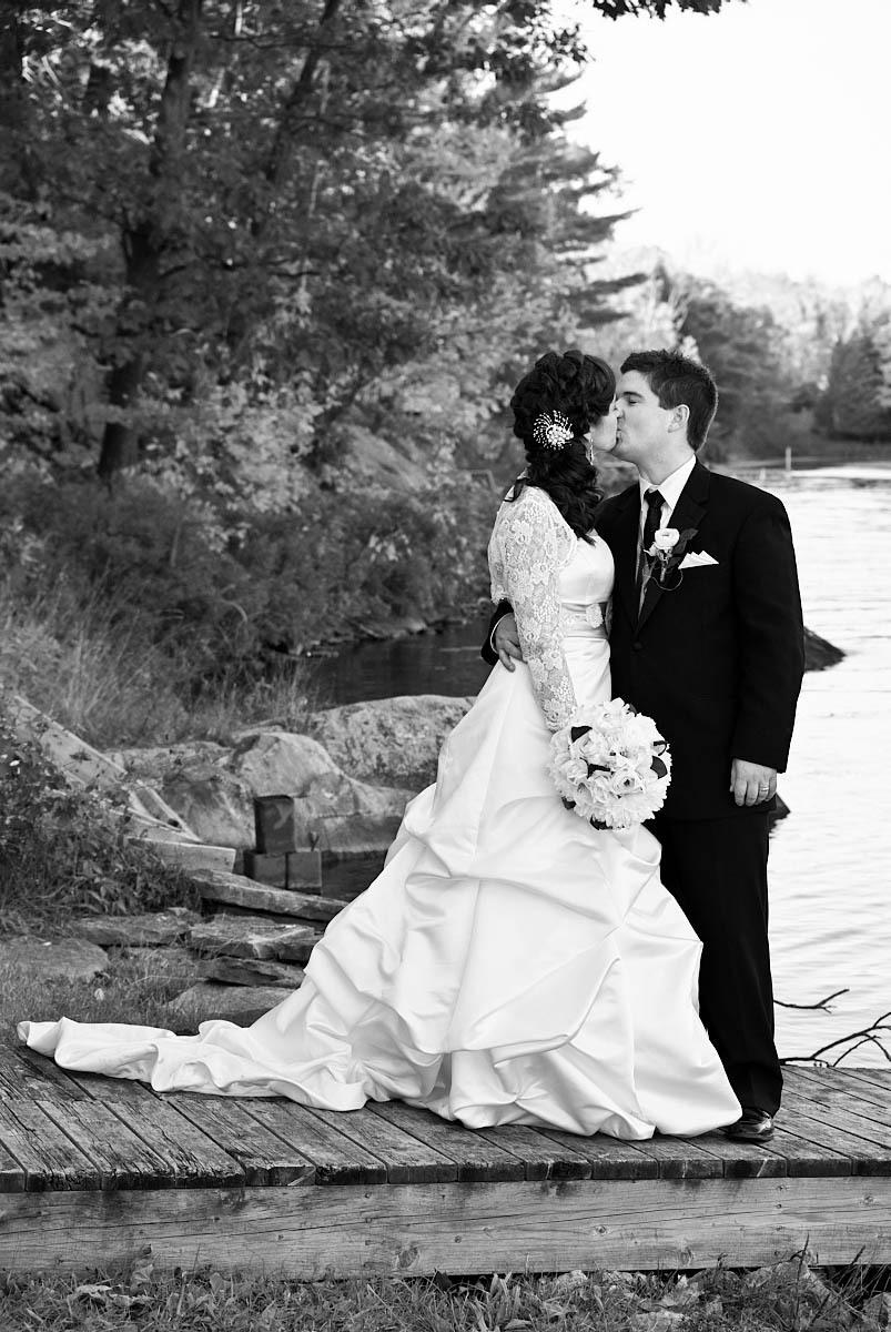 bride and groom by stoney lake at kawartha lakes wedding on stoney lake at viamede resort