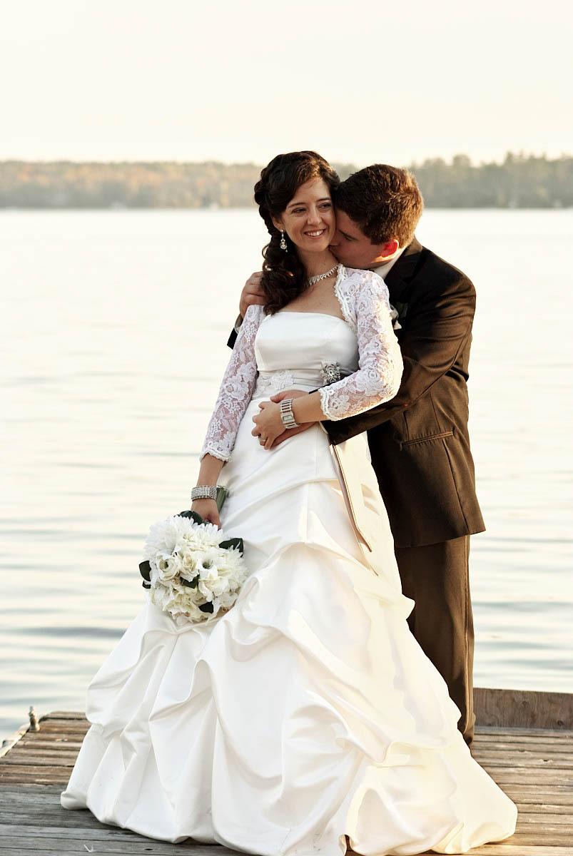 bride and groom on dock at viamede resort wedding