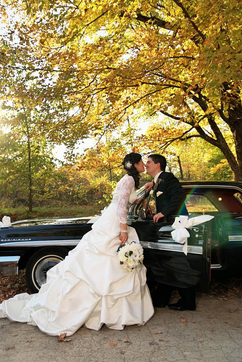 bride and groom with vintage car at viamede resort wedding
