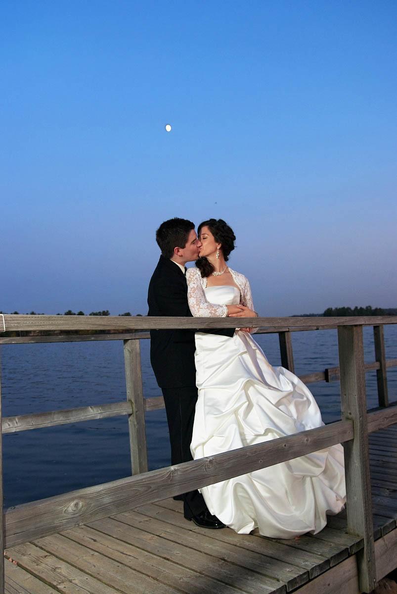 bride and groom on dock at night at viamede resort wedding