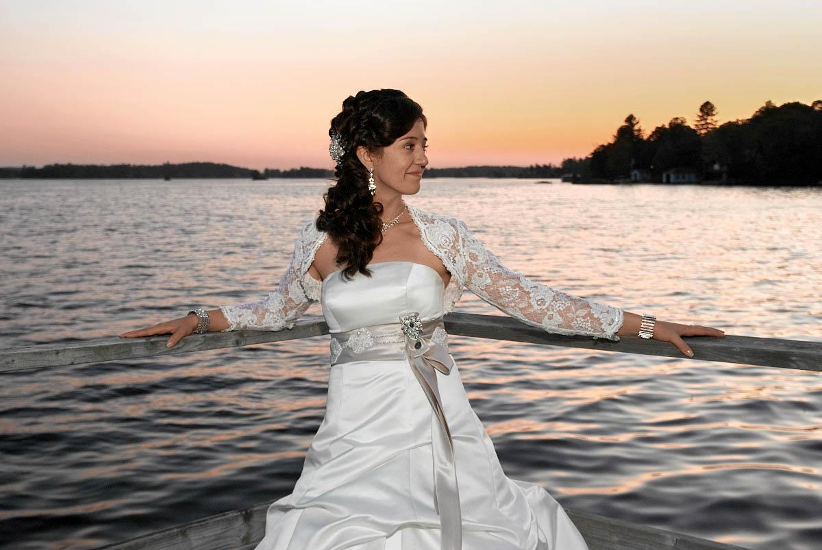 bride on dock at night at viamede resort wedding