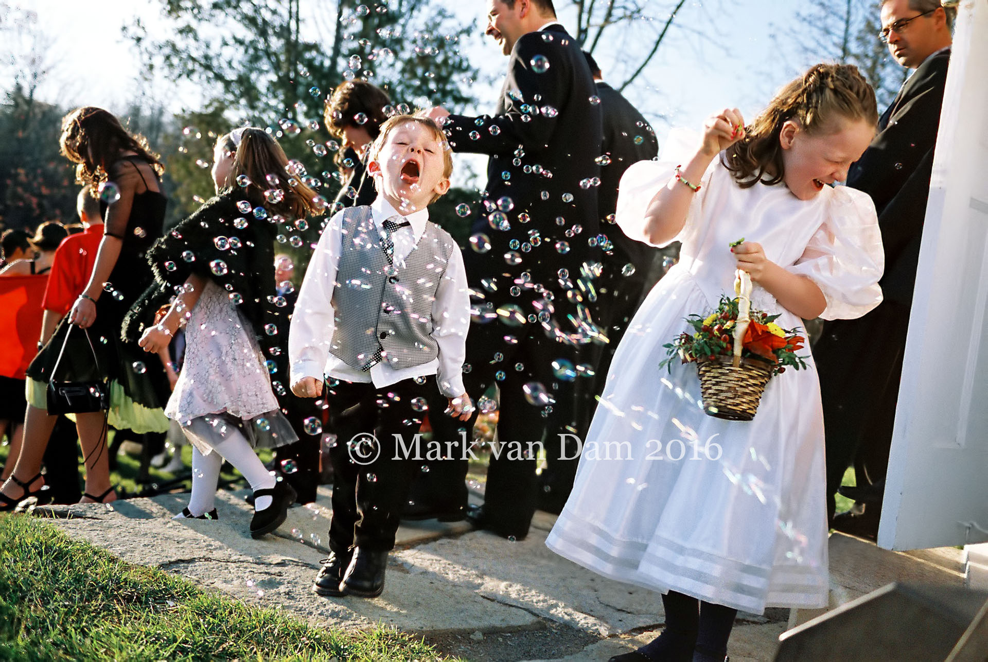 Boy cathces bubbles with mouth at Viamede Resort wedding photography session
