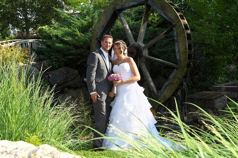 bride and groom by waterwheel nottawasaga
