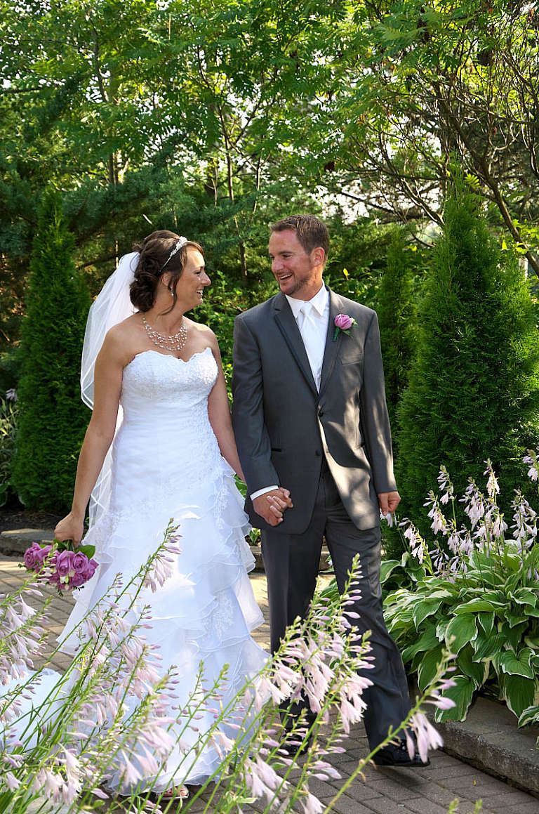 bride and groom hand in hand nottawasaga