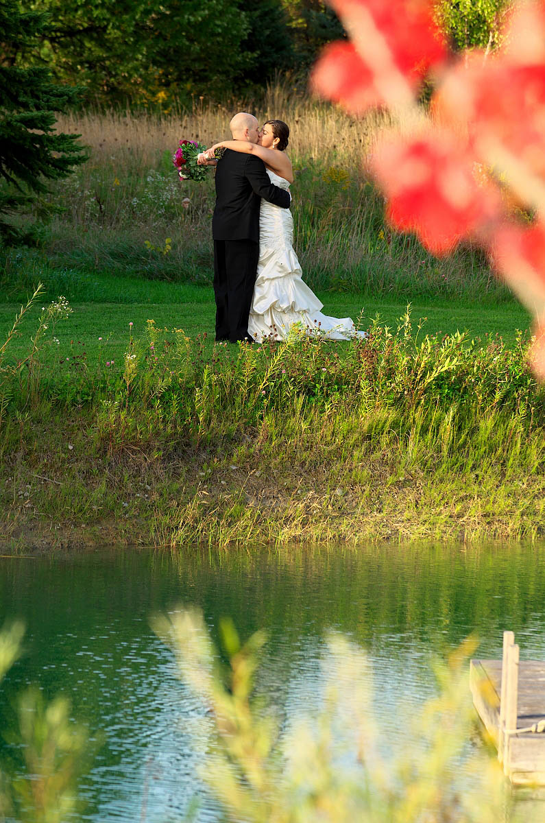 bride and groom kiss in fall at belcroft