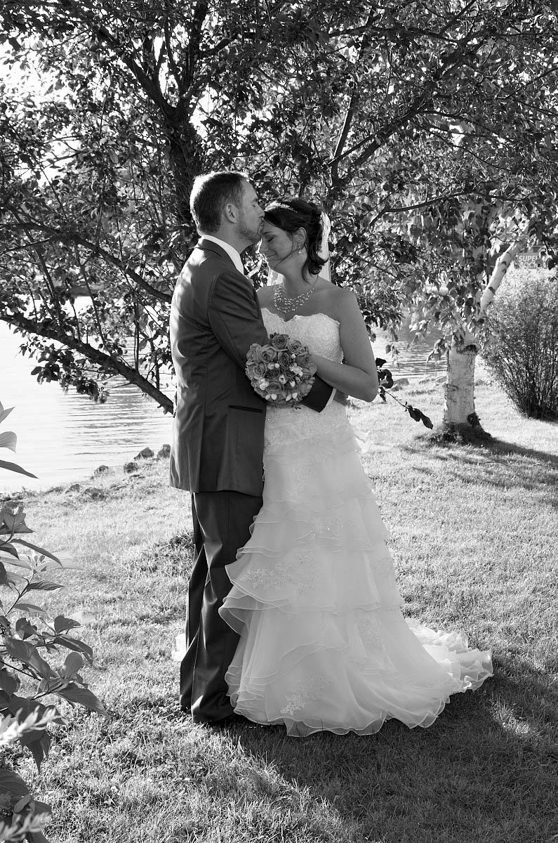 groom kisses bride on head nottawasaga