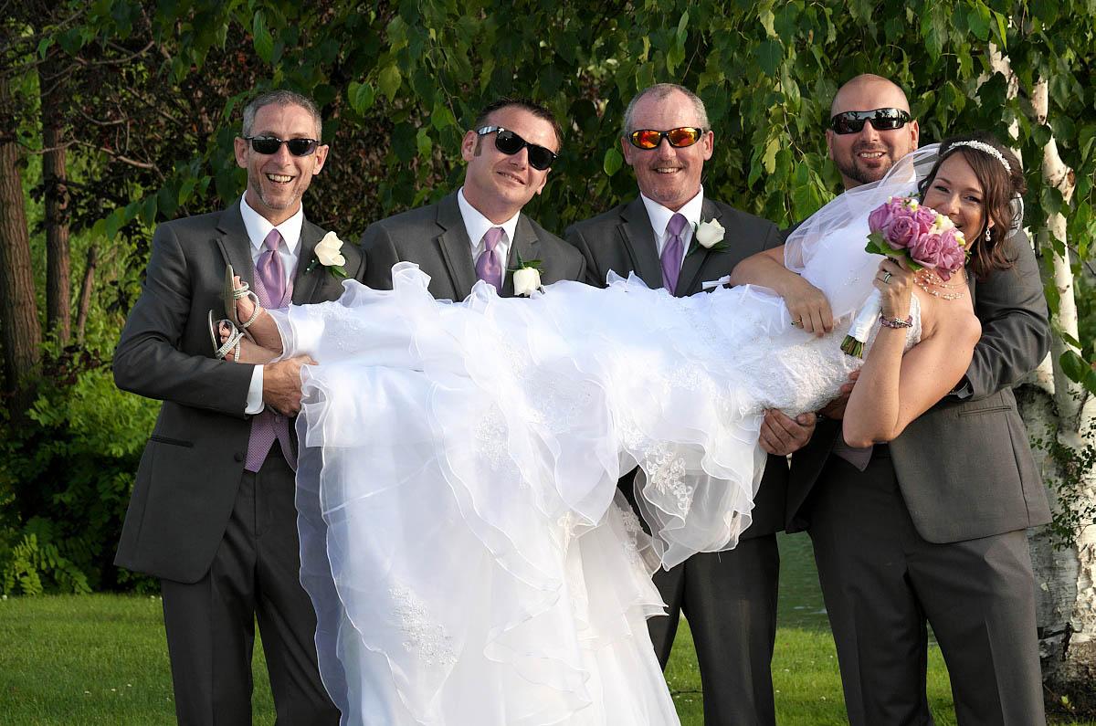 groomsmen lift bride nottawasaga