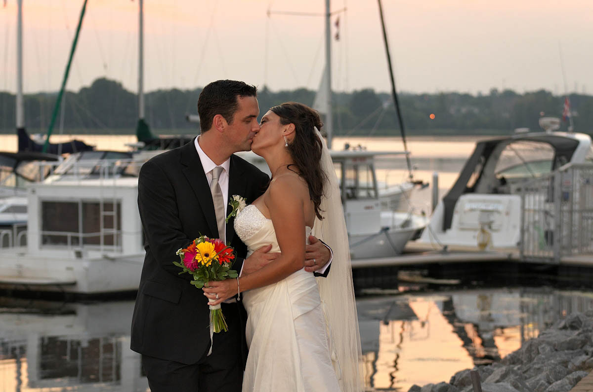 The Lake Hose weding photographer captures couple at sunset by Lake Ontario Yacht Club
