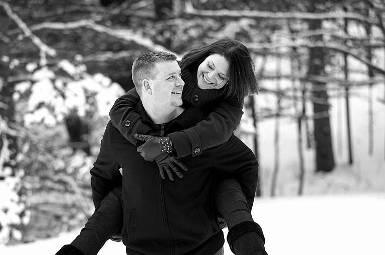 Winter piggyback at Wasaga Beach Provincial Park forest dring Wasaga engagement phtoography session