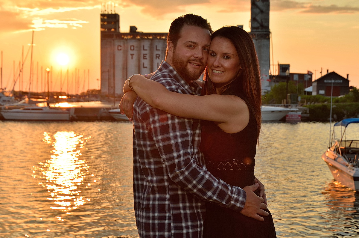 Couple embraces at sunset in front of Collingwood terminals at Collingwood photography session
