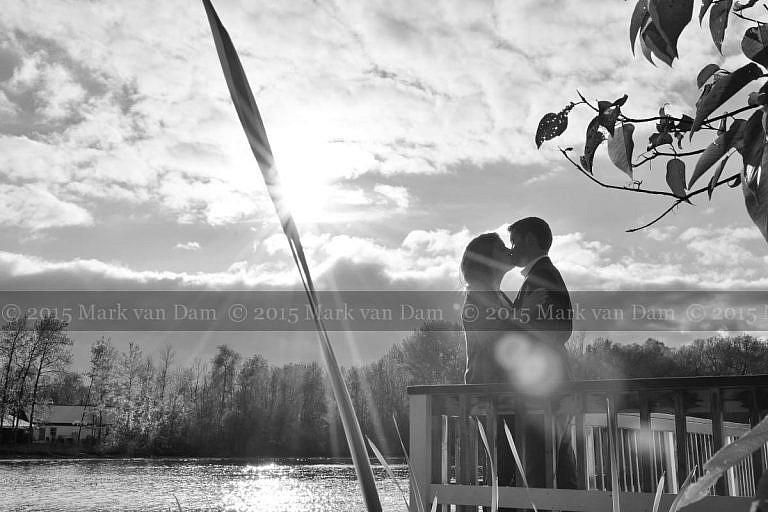 Couple Kissing on Leacock Museum boathouse with sunburst