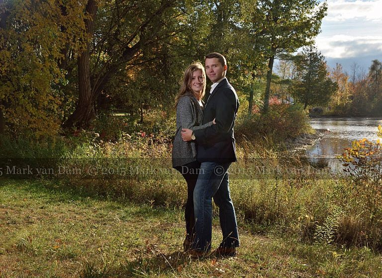Young couple hugs by shoreline at Stephen Leacock Museum in Orillia