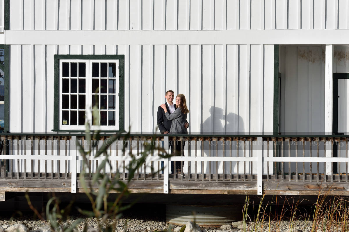 Couple by boathouse at Stephen Leacock Museum, with their shadows kissing