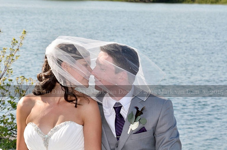 Collinwood photographer, Beautiful bride and handsome groom on rocks by water at Cranberry Resort wedding in Collingwood