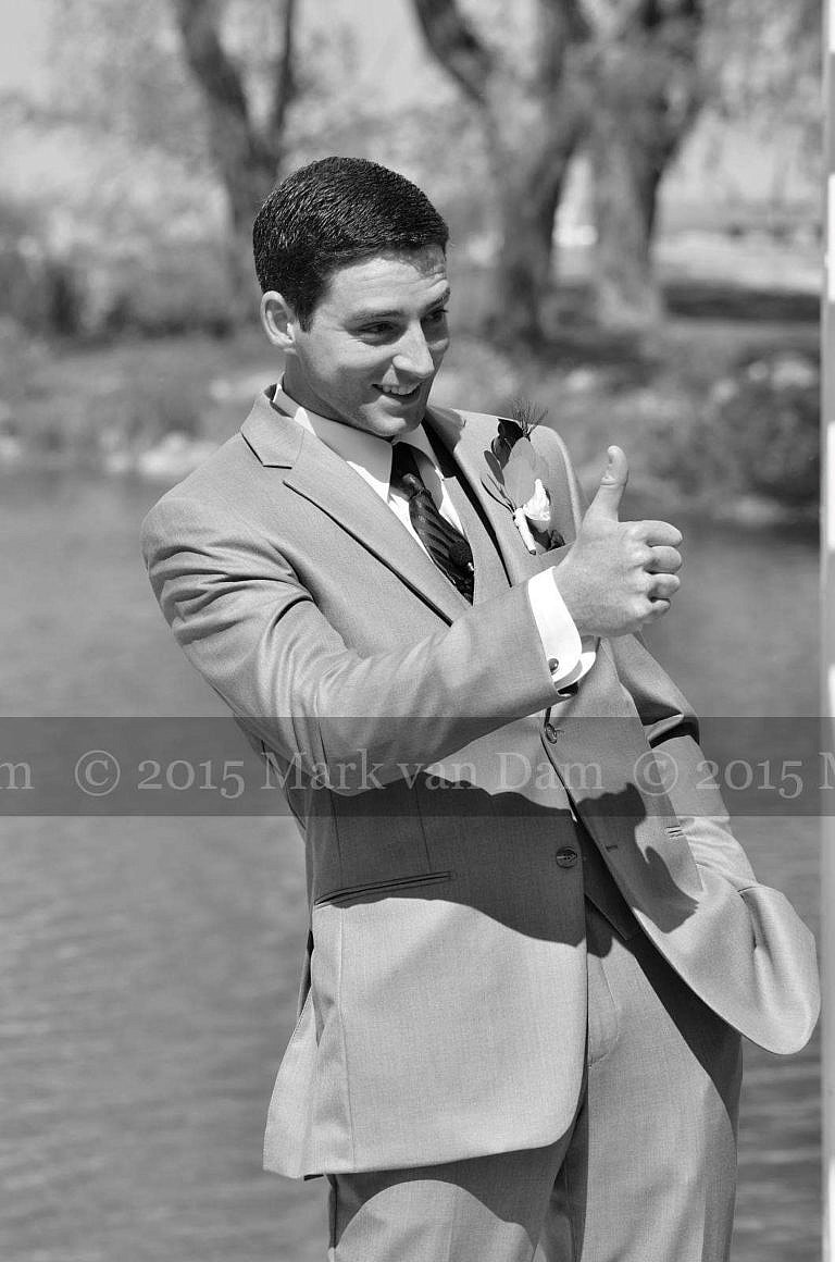 collingwood photographer, groom gives a thumbs up while waiting for his beautiful bride at Cranberry Resort Bear Estate Living Waters wedding