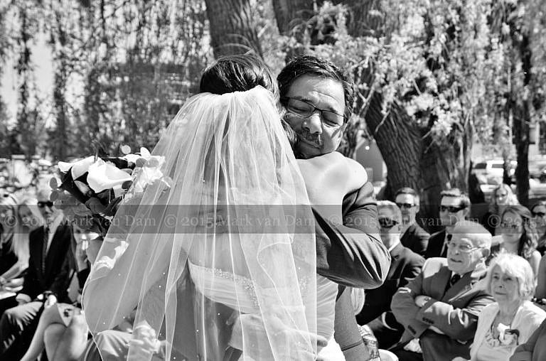 Collingwood photographer, bride hugs father after he walks her down aisle at beginning of Cranberry Resort wedding