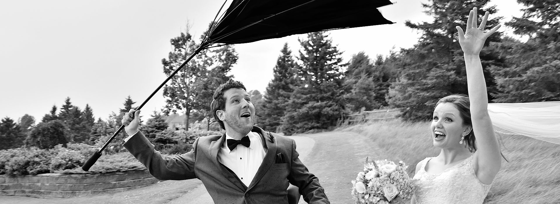 August Gale Inverts Groom's umbrella during photo shoot