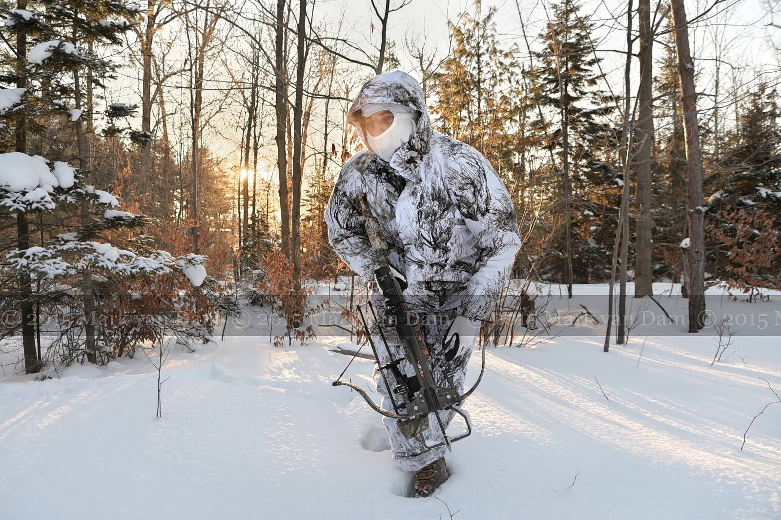Winter Crossbow Photography, still hunting in deep snow with snow camo