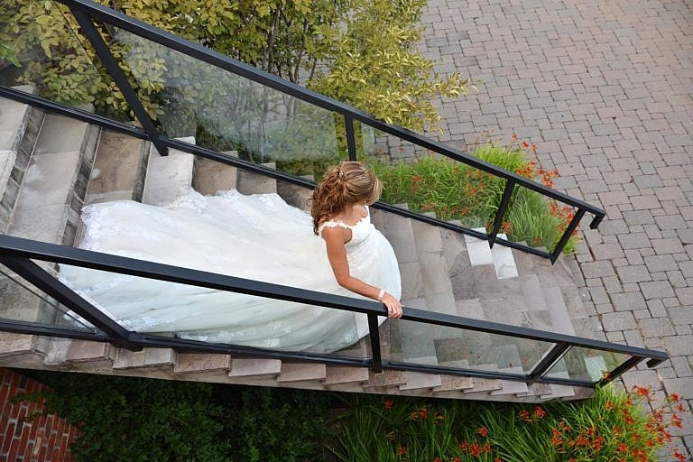Bride descending stairs at The Club at Bond Head