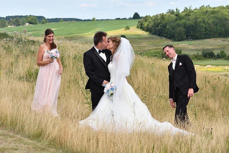 Wedding party in meadow at Bond Head wedding