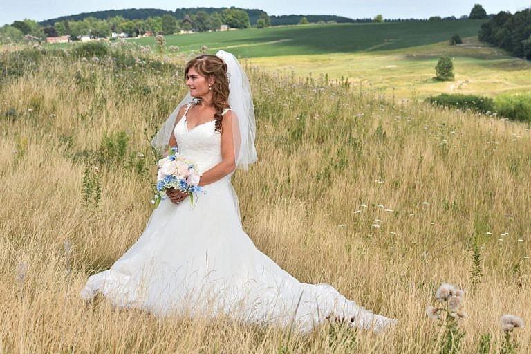 Beautiful bride in meadow at Bond Head wedding